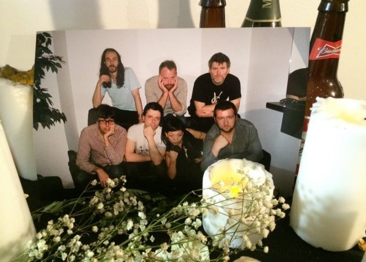 LCD-Soundsystem-The-Long-Goodbye-Interactive-Exhibit-Band-Photo-Flowers-Bottles-beer-candles