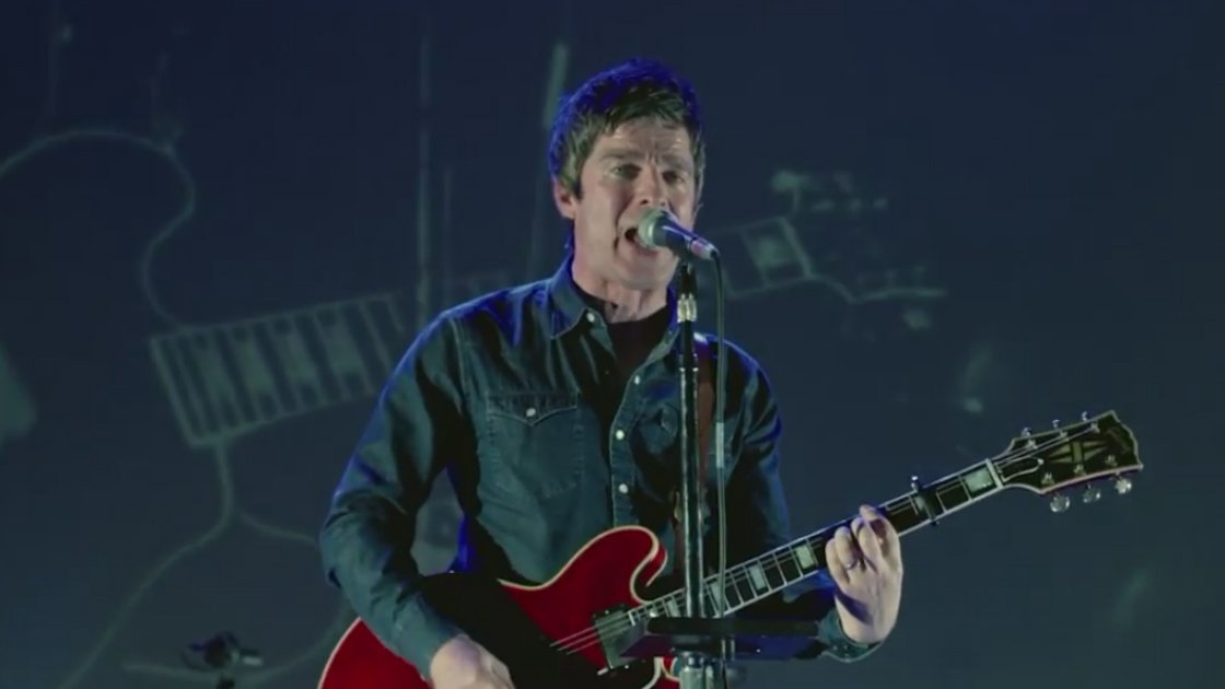 noel-gallagher-high-flying-birds-lock-all-the-doors-music-video-playing-guitar-singing